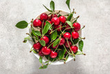 Fresh cherry on plate on white background, ripe cherries, sweet fruit, top view