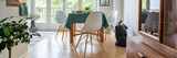 Three white wooden chairs by the table in vintage kitchen with terrace in elegant apartment, real photo - 228679877