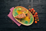 Baked chicken fillet with sesame and zucchini. On the old background. Free copy space. Top view. - 228693614