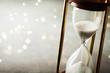 Leinwanddruck Bild - Sand running through the hourglass. Time keeper concept. Boke effect.