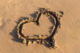 Heart shape on the sand at the sea beach. - 228701495