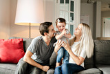 Family mother, father, child daughter at home - 228702403