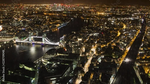 Fototapeta Time Lapse of tower bridge with London cityscape at night, England