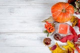 Chestnut and autumnal  leaves on the wooden background - 228715674