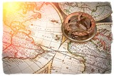 old map and compass , navigation and geography