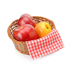 Apples in a wicker basket isolated on white background.