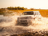 Off-road car fording water on safari wild drive in Chobe National Park, Botswana, Africa