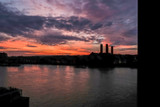 Sunrise over the power station at Greenwich, fire in the sky - 228744249