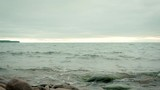 Gentle waves rolling into shore from Lake Superior - 228762615