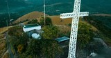 Aerial - drone flying over hill with a cross. Mt. Tapyas, Coron, Palawan, Philippines. - 228773271