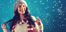 """Постер, картина, фотообои """"Happy young woman in winter clothes in a snowy night"""""""