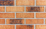 Background of brown building bricks. A wall of bricks.