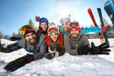 Happy skiers together on winter vacation - 228801628