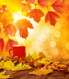 Autumn leaves and red cup of coffee . - 228819820