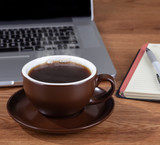 Steaming Cup of Coffee on a Desktop