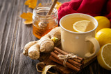 Autumn hot drink - ginger, lemon, honey tea and ingredients, wood back - 228847612