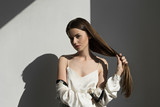 image of attractive woman showing her  long hair - 228848637