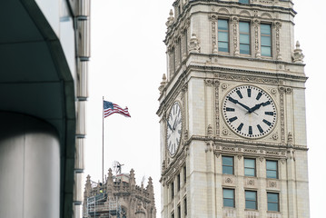 Clocktower in Downtown Chicago with American Flag