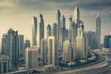 Aerial daytime skyline of Dubai Marina, UAE, with skyscrapers in the distance. Scenic travel background. - 228878208