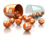 Vitamin B12 capsule isoilated on white. Pill with cobalamin. Dietary supplements. - 228878693