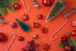 Christmas holiday background with decorations and ornaments on red table
