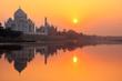 Leinwanddruck Bild - Taj Mahal reflected in Yamuna river at sunset in Agra, India