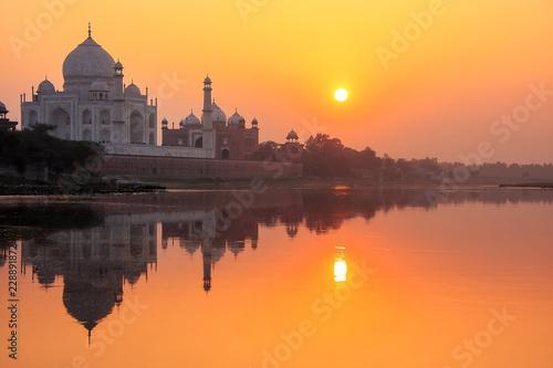 Leinwanddruck Bild Taj Mahal reflected in Yamuna river at sunset in Agra, India