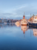 Stockholm winter image with old ship reflecting in thin ice. - 228895829