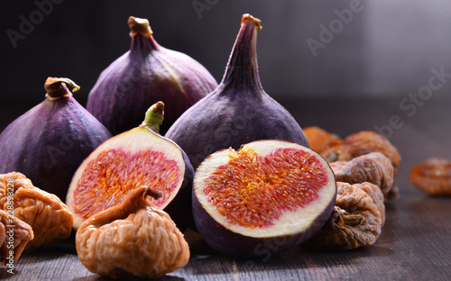 Composition with fresh and dried figs on wooden table - 228898228