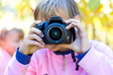Young girl with camera in her hands_ - 228903060