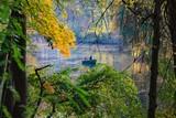 Romantic scene in the autumn park. The couple in the boat. - 228907095