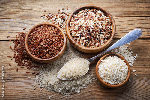 Four types of rice: basmati, mix long grain, arborio and red rice. Top view - 228908473