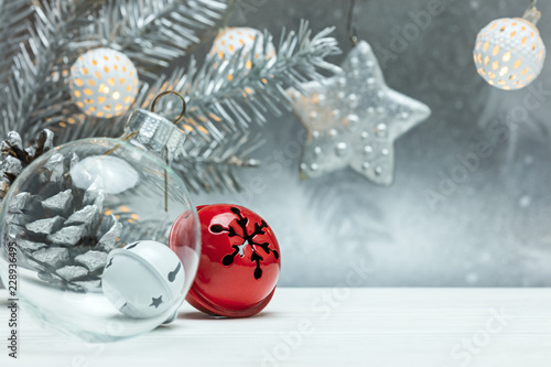 Leinwandbild Motiv christmas tree decorations on blurred silver background with fir tree branch and retro garlands