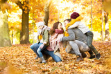 family time in sunny autumn landscape - 228940454