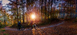 Cycling, mountain biker couple on cycle trail in autumn forest. Mountain biking in autumn landscape forest. Man and woman cycling MTB flow uphill trail. - 228940871