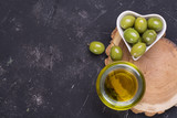 olives with olive oil on dark background