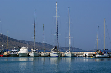 Sailing yachts in a bay of the sea about a mooring. © Владимир Журавлёв