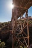 underneath a old bridge with sunburst