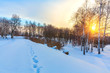 Colorful sunset in countryside at winter