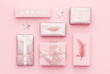 Gift wrapping. Pink nordic christmas gifts isolated on pastel pink background. Wrapped xmas boxes. - 228981473