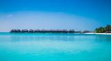 Beautiful beach with white sand at tropical Olhuveli island,  Maldives.