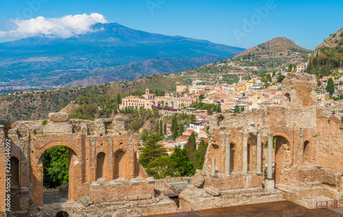 Leinwandbild Motiv Ruins of the Ancient Greek Theater in Taormina with the Etna volcano in the background. Province of Messina, Sicily, southern Italy.