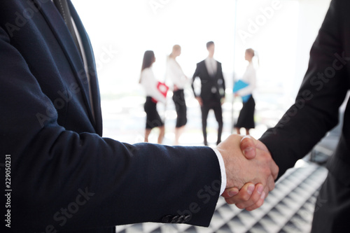 Wall mural Business handshake at meeting