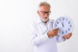 Studio shot of handsome senior bearded man doctor using stethosc