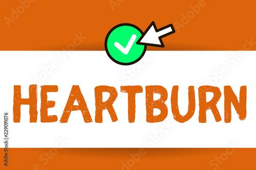 Conceptual hand writing showing Heartburn  Business photo