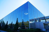 close up on modern company building exterior with blue glass - 229100035