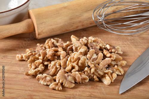 Shelled walnuts on a cutting board - 229109268