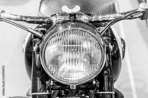 old motorcycle close-up, front light and motorcycle handlebar - 229110872
