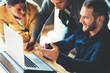 Leinwandbild Motiv Startup and millenial business concept. Team leader explains the new strategy company plan