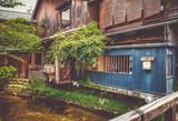 Traditional japanese houses on Shirakawa river, Gion district, Kyoto, Japan - 229133026